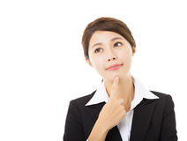 Smiling businesswoman with thinking gesture. Young smiling businesswoman with thinking gesture Royalty Free Stock Photo