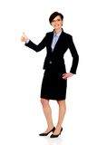 Smiling businesswoman with thumbs up. Happy smiling businesswoman with thumbs up gesture royalty free stock photos