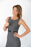 Smiling businesswoman with thumbs up standing  Stock Images