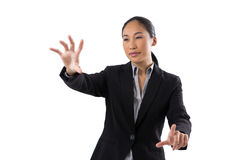 Smiling businesswoman touching the invisible screen Stock Photos