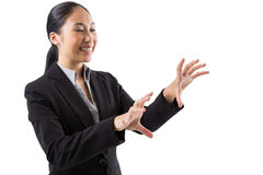 Smiling businesswoman touching the invisible screen Royalty Free Stock Photography