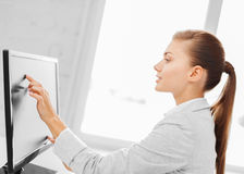 Smiling businesswoman with touchscreen in office Stock Image