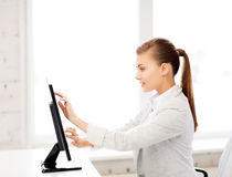 Smiling businesswoman with touchscreen in office Stock Photography