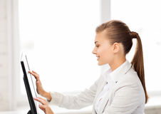 Smiling businesswoman with touchscreen in office Royalty Free Stock Photo