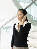Smiling Businesswoman Using Cellphone Stock Photos
