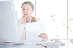 Smiling businesswoman using computer Stock Image