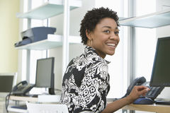 Smiling Businesswoman Using Computer In Office Stock Photography