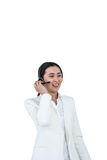 Smiling businesswoman using headset Stock Photos
