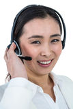 Smiling businesswoman using headset Stock Image