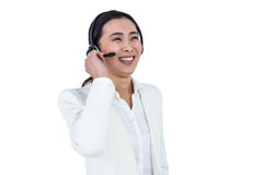 Smiling businesswoman using headset Stock Images