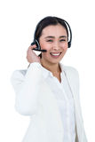 Smiling businesswoman using headset Royalty Free Stock Photos