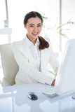 Smiling businesswoman using her computer Royalty Free Stock Images