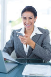 Smiling businesswoman using her smartphone Royalty Free Stock Photos