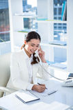 Smiling businesswoman using her telephone Stock Photos