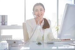 Smiling businesswoman using her telephone Stock Photo