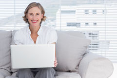 Smiling businesswoman using a laptop Stock Photography