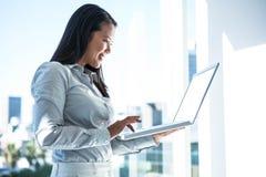Smiling businesswoman using laptop Royalty Free Stock Photo