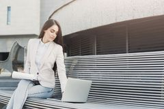 Caucasian businesswoman working with papers outdoors Stock Photography