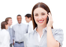 Smiling businesswoman using a mobile phone Stock Photography