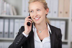 Smiling Businesswoman Using Mobile Phone Stock Image