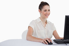 Smiling businesswoman using a monitor Royalty Free Stock Photo