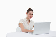 Smiling businesswoman using a notebook Stock Photo