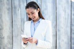 Smiling businesswoman using smartphone Stock Photos