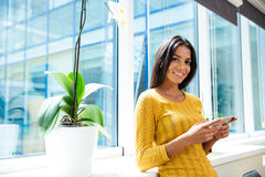 Smiling businesswoman using smartphone Royalty Free Stock Photo