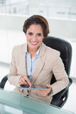 Smiling businesswoman using tablet Royalty Free Stock Photography
