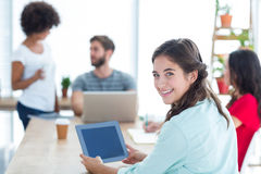 Smiling businesswoman using tablet Stock Images