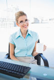 Smiling businesswoman wearing glasses holding coffee Royalty Free Stock Images