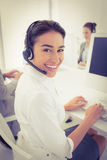 Smiling businesswoman wearing headset Royalty Free Stock Photos
