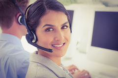 Smiling businesswoman wearing headset Royalty Free Stock Images
