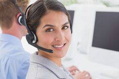 Smiling businesswoman wearing headset Royalty Free Stock Image