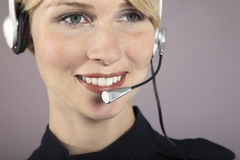 Smiling Businesswoman Wearing Headset Royalty Free Stock Photos
