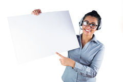 Smiling businesswoman wearing headset and holding white sheet Stock Photography
