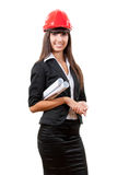 Smiling businesswoman wearing red helmet. Holding blueprint Stock Photos