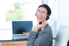 Smiling businesswoman wearing a work headset Royalty Free Stock Images