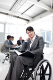 Smiling businesswoman in a wheelchair Stock Photos