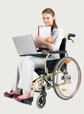Smiling businesswoman on wheelchair Royalty Free Stock Photos