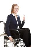 Smiling businesswoman on a wheelchair Royalty Free Stock Photography