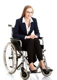Smiling businesswoman on a wheelchair Royalty Free Stock Images