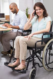 Smiling businesswoman in wheelchair on the phone Royalty Free Stock Photos