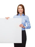 Smiling businesswoman with white blank board Royalty Free Stock Image