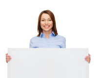 Smiling businesswoman with white blank board Royalty Free Stock Photos