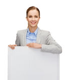 Smiling businesswoman with white blank board Stock Photo