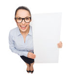Smiling businesswoman with white blank board Stock Photos