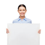 Smiling businesswoman with white blank board Stock Images