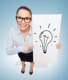 Smiling businesswoman with white board Royalty Free Stock Photography