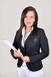 Smiling businesswoman with white file Royalty Free Stock Photo